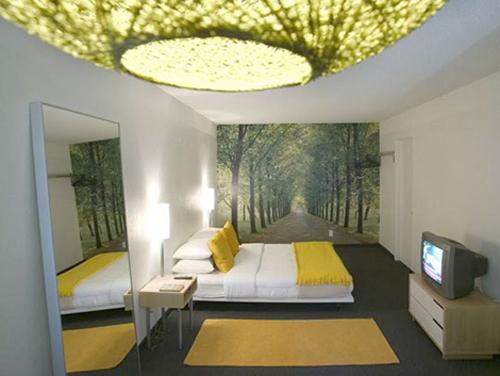 Slaapkamer van Jupiter Hotel  Interieur inrichting