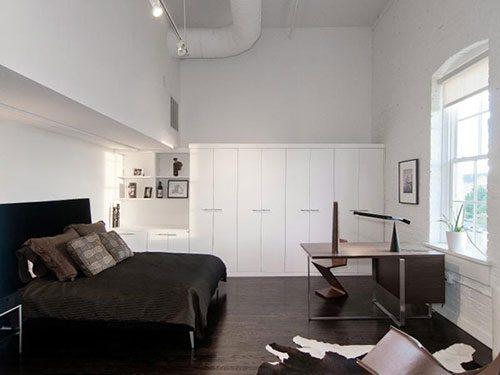 Slaapkamer van industriele loft in Utah