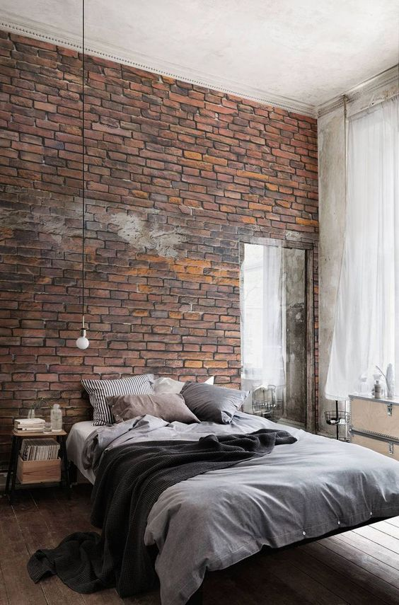 Bakstenen muur in slaapkamer