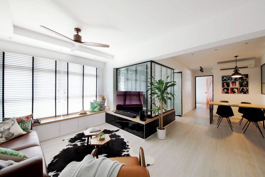 Deze l-vormige woonkamer is erg leuke en speels ingericht ...