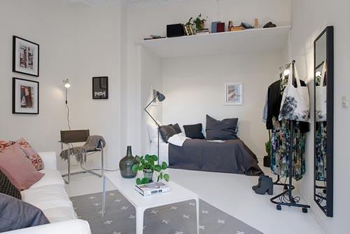 Driehoekige woonkamer van 1 kamer appartement interieur inrichting - Kamer inrichting ...