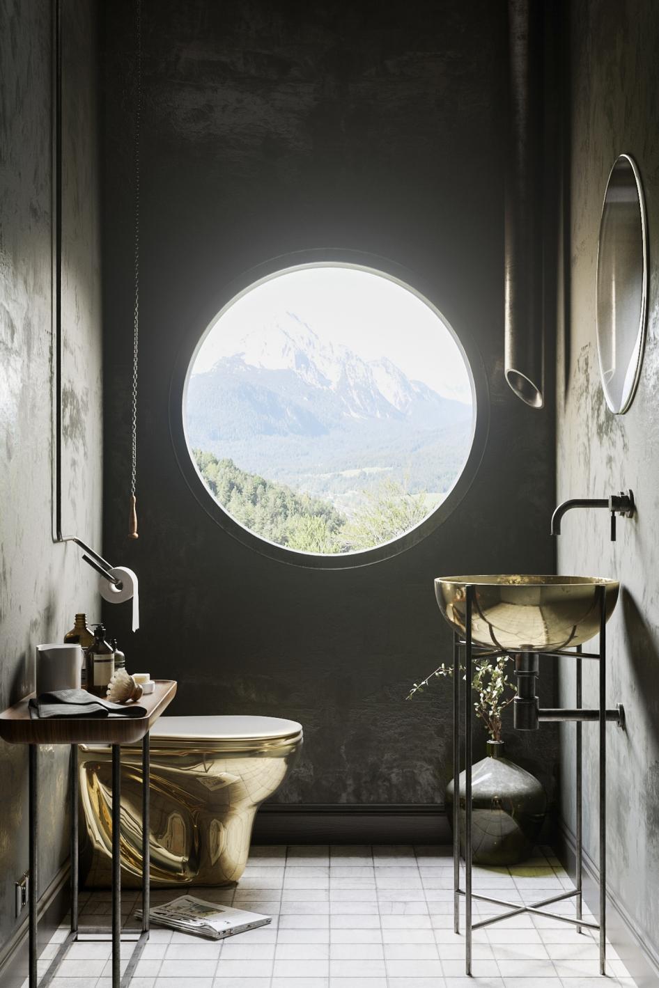Een gouden toiletpot en bijbehorend fonteintje