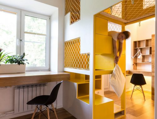 Kinderkamer met een indrukwekkend speelhuis