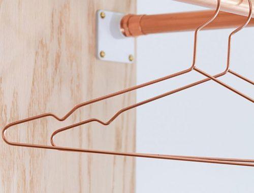 Koperen kledinghangers