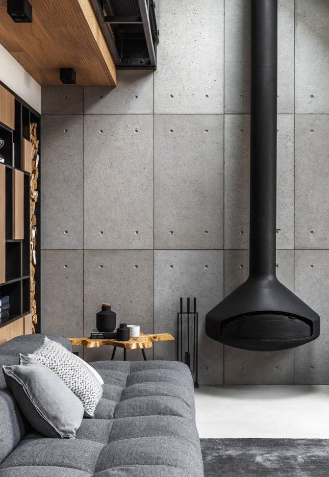 living inspiratie grote design houtkachel moderne woonkamer betonlook tegels