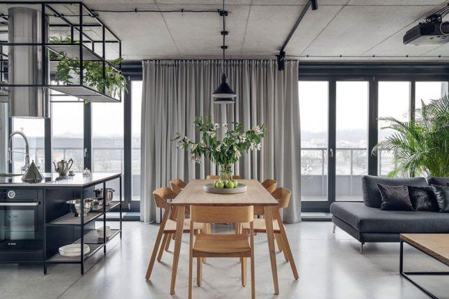 living inspiratie houten eettafel tussen open keuken woonkamer