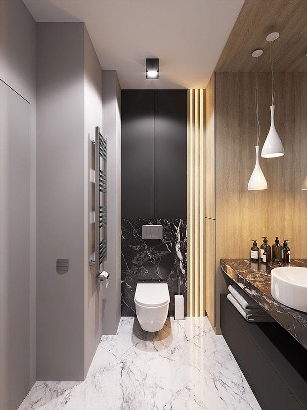 Ontwerpbureau FonBureau koos voor een combinatie van wit en zwart marmer in dit luxe toilet.
