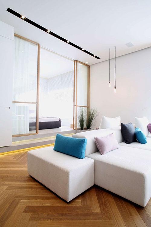 Slaapkamer inrichting achter glazen schuifdeuren