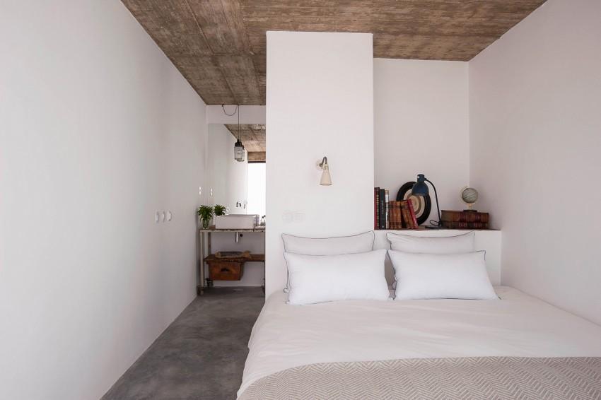 slaapkamers met strakke witte wanden en betonvloer interieur inrichting