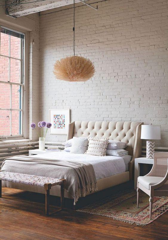 Witte bakstenen muur slaapkamer