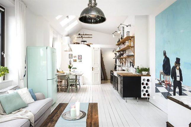 Zwarte open keuken in een klein wit appartement van m