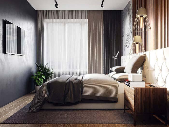 Zwarte tv aan zwarte muur slaapkamer